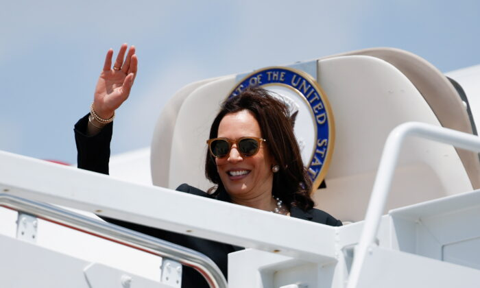 Vice President Kamala Harris waves as she boards Air Force Two for her first international trip as vice president to Guatemala and Mexico, at Joint Base Andrews, Maryland, U.S., on June 6, 2021. (Carlos Barria/Reuters)