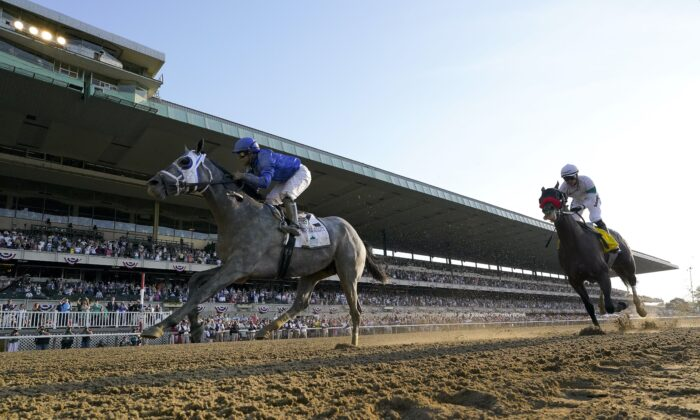 Essential Quality (2), with jockey Luis Saez up, crosses the finish line ahead of Hot Rod Charlie (4), with jockey Flavien Prat up, to win the 153rd running of the Belmont Stakes horse race, at Belmont Park in Elmont, N.Y., on June 5, 2021. (Seth Wenig/AP Photo)