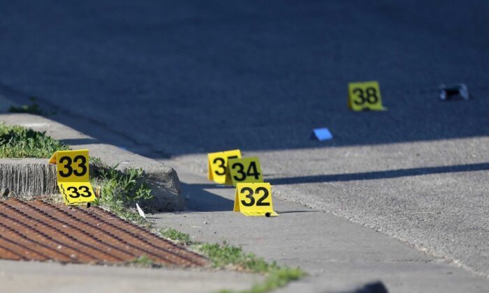 Evidence markers at the crime scene in the 8900 block of South Cottage Grove Avenue on Chicago's South Side in Chicago, Ill., on June 6, 2021. (Vashon Jordan Jr./Chicago Tribune/TNS)