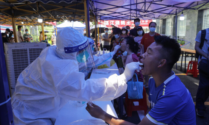 A man receives a nucleic acid test for COVID-19 in Guangzhou, a city in southern China's Guangdong Province, on May 30, 20210. (STR/AFP via Getty Images)