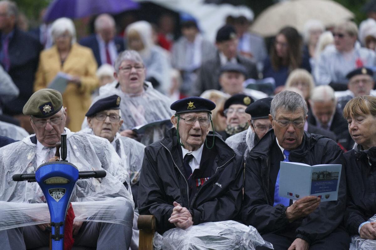 Veterans sing at the National Memorial Arboretum in Alrewas, England
