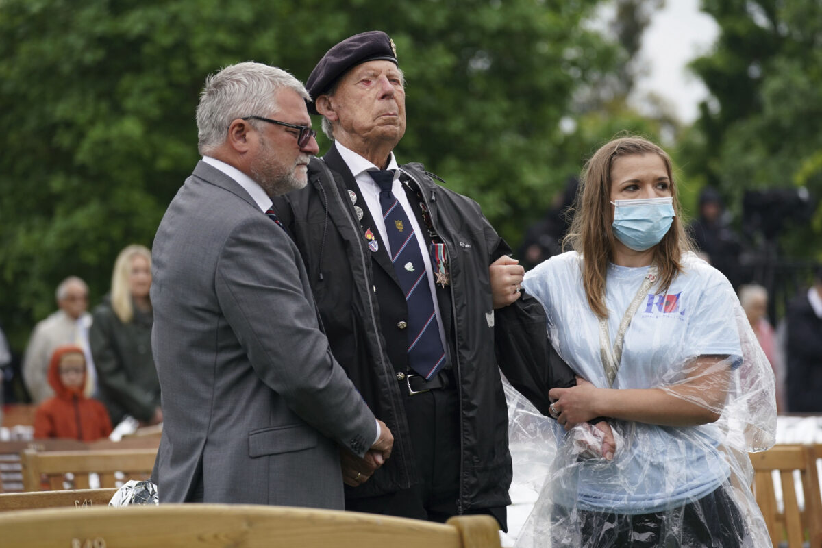 A veteran is assisted at the National Memorial Arboretum in Alrewas, England