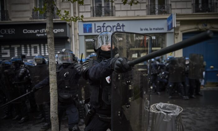 French Riot Police shout at protestors near Place de la Republique in Paris, France, on May 1, 2021. (Kiran Ridley/Getty Images)