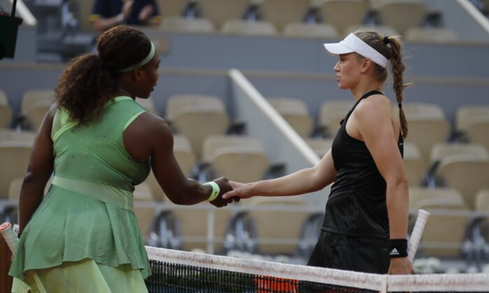 United States Serena Williams hands with Kazakhstan's Elena Rybakina after losing their fourth round match at the French Open tennis tournament at Roland Garros in Paris, France, on June 6, 2021. (Sarah Meyssonnier/Reuters)