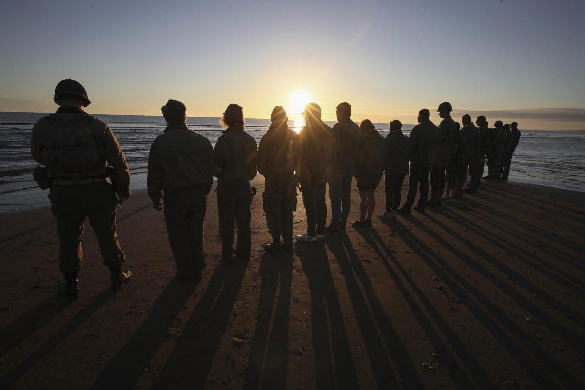 WWII reenactors on Omaha Beach in Saint-Laurent-sur-Mer