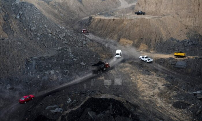 Miners with heavy machinery work in an opencast coal mine in Agujita, Coahuila State in Mexico, in a file photo. (Yuri Cortez/AFP via Getty Images)