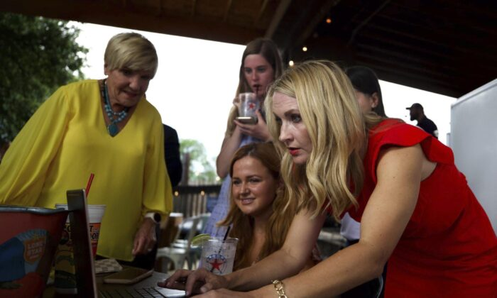 Mattie Parker (R) with Fort Worth Mayor Betsy Price (L) look at early voting results at a gathering in Fort Worth, Texas, on June 5, 2021. Parker won the election as the next Fort Worth mayor. (Yffy Tossifor/Star-Telegram via AP)