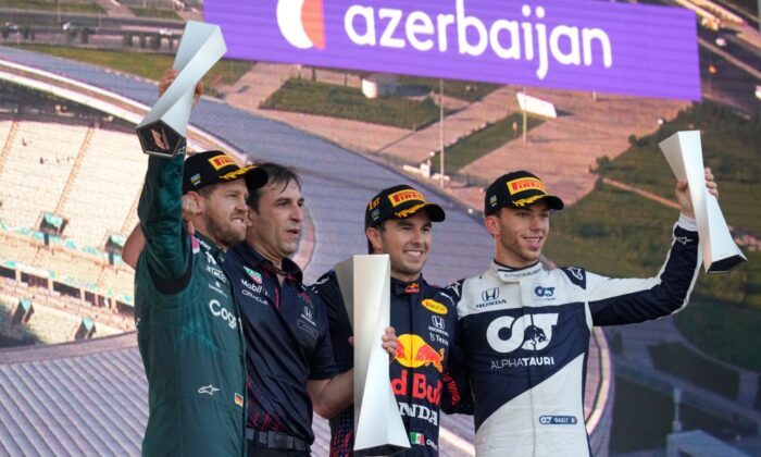 First place, Red Bull driver Sergio Perez of Mexico (2nd-R) stands on the podium with second place, Aston Martin driver Sebastian Vettel of Germany (L) and third place, AlphaTauri driver Pierre Gasly of France (R) during the Formula One Grand Prix at the Baku Formula One city circuit in Baku, Azerbaijan, on June 6, 2021. (Darko Vojinovic/AP Photo)
