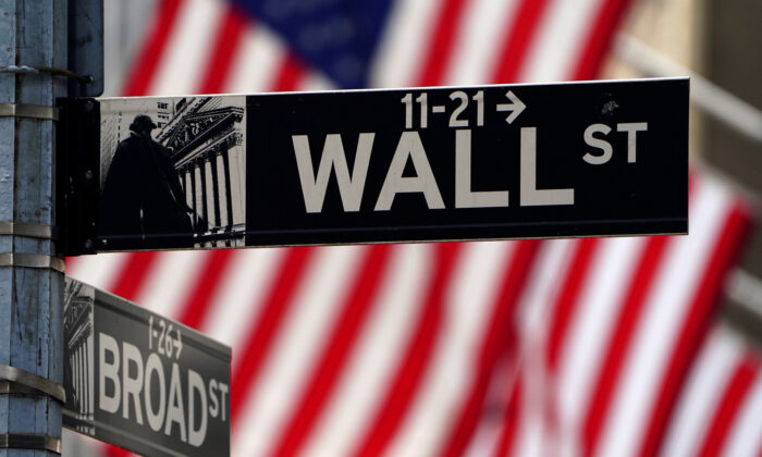 A Wall Street sign outside the New York Stock Exchange in Manhattan on April 16, 2021. (Carlo Allegri/Reuters)