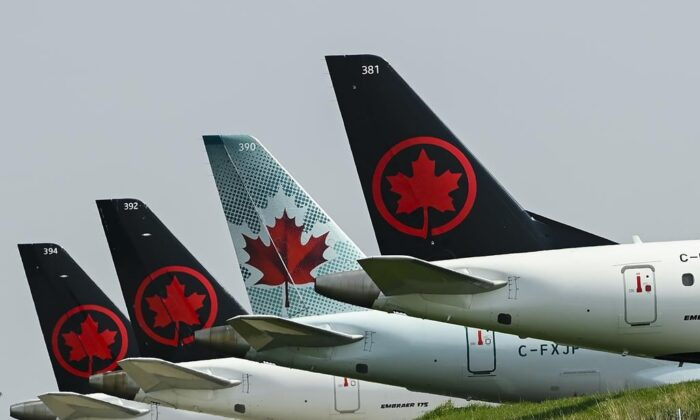 Grounded Air Canada planes sit on the tarmac at Pearson International Airport  during the COVID-19 pandemic in Toronto on April 28, 2021. (The Canadian Press/Nathan Denette)