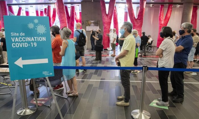 Some people eligible for a second COVID-19 vaccination shot wait in line at the Palais des congres vaccination site in Montreal on June 6, 2021, as the COVID-19 pandemic continues in Canada and around the world. (The Canadian Press/Graham Hughes)