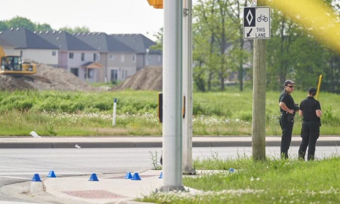 London Police investigate the scene of a car crash in London, Ontario on June 7, 2021. Police in London, Ont., say four people have died after several pedestrians were struck by a car Sunday night. (The Canadian Press/Geoff Robins)