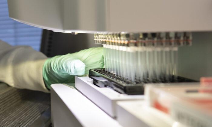 A researcher works on the development of the medication aducanumab in Cambridge, Mass., in 2019. (Biogen via AP)