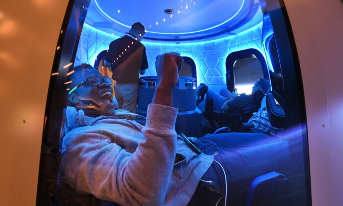 Participants enjoy the Blue Origin Space Simulator during the Amazon Re:MARS conference on robotics and artificial intelligence at the Aria Hotel in Las Vegas, Nevada on June 5, 2019. (MARK RALSTON/AFP via Getty Images)