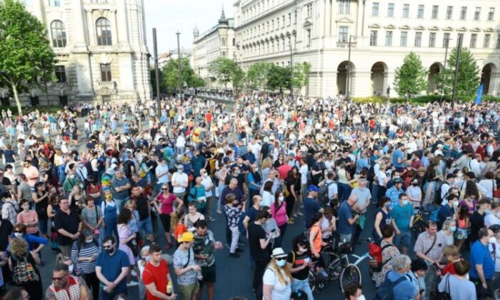 Demonstrators take part in a protest against the planned construction of Chinese Fudan university campus in Budapest, Hungary, on June 5, 2021. (Ferenc Isza/AFP via Getty Images)