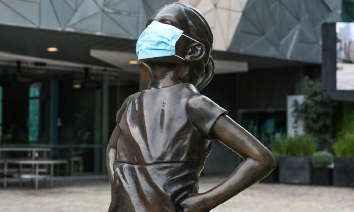 The Fearless Girl Statue in Federation square is seen with a face-mask on June 5, 2021 in Melbourne, Australia. (Asanka Ratnayake/Getty Images)