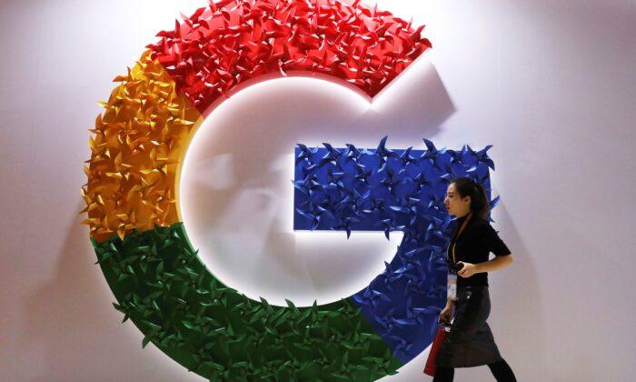 A woman walks past the logo for Google at the China International Import Expo in Shanghai, China, on Nov. 5, 2018. (Ng Han Guan/AP Photo)