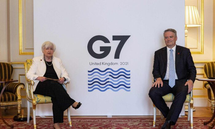 OECD Secretary General Mathias Cormann (R) meets with U.S. Treasury Secretary Janet Yellen (L) in London on June 5, 2021. (Rob Pinney/AFP via Getty Images)