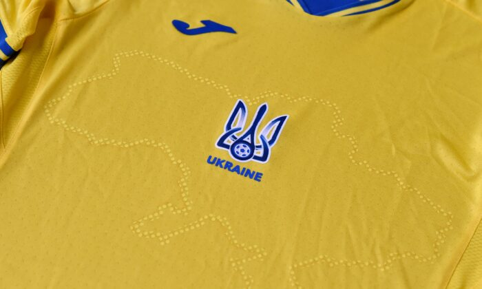 """A EURO 2020 jersey of the Ukrainian national football team. The uniforms in the blue-and-yellow colors of the Ukrainian flag feature the silhouette of Ukraine that includes Russia-annexed Crimea and the separatist-controlled regions of Donetsk and Lugansk as well as the words """"Glory to Ukraine! Glory to the Heroes!"""" on  June 6, 2021. (STRINGER/AFP via Getty Images)"""