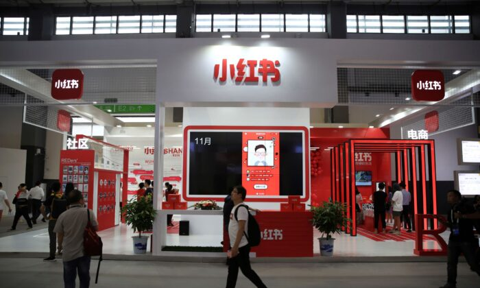A man walks past the booth of Chinese startup Xiaohongshu at the Big Data Expo in Guiyang, Guizhou province, China, on May 27, 2019. (Stringer/Reuters)