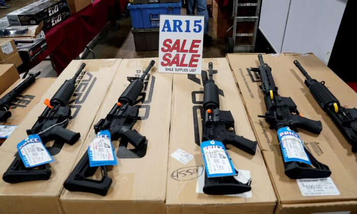 AR-15 rifles are displayed for sale at the Guntoberfest gun show in Oaks, Pa., on Oct. 6, 2017. (Joshua Roberts/Reuters)