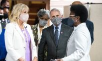 Fauci, First Lady Visit Vaccination Clinic as Protesters Call for Firing