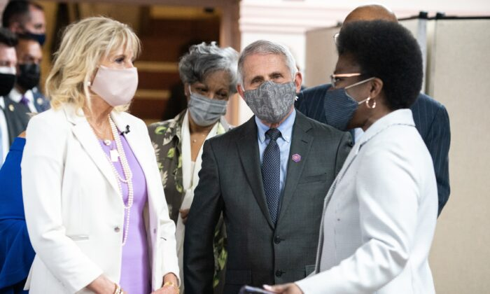 First Lady Jill Biden (L) and Dr. Anthony Fauci (C), director of the National Institute of Allergy and Infectious Diseases, speak with members of the Abyssinian Baptist Church in New York City on June 6, 2021. (Jeenah Moon/Getty Images)