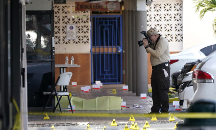 Miami-Dade Police work the scene of a shooting outside of a banquet hall near Hialeah, Fla., on May 20, 2021. (Lynne Sladky/AP Photo)