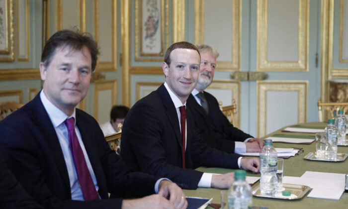 CEO and co-founder of Facebook Mark Zuckerberg poses next to Facebook head of global policy communications and former UK deputy prime minister Nick Clegg (L) prior to a meeting with French President at the Elysee Palace in Paris on May 10, 2019. (YOAN VALAT/AFP via Getty Images)