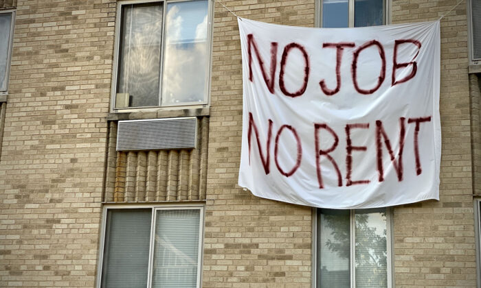 """A banner against renters eviction reading """"no job, no rent"""" is displayed on a controlled rent building in Washington, D.C. on Aug. 9, 2020. (Eric Baradat/AFP via Getty Images)"""