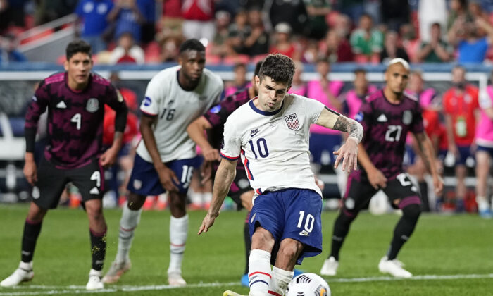 United States' Christian Pulisic (10) kicks a penalty kick for a goal against Mexico during extra time in the CONCACAF Nations League championship soccer match, in Denver, Colo., on June 6, 2021. (Jack Dempsey/AP Photo)