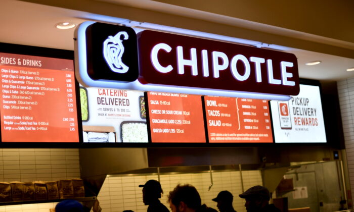 Customers order from a Chipotle restaurant as pre-Thanksgiving and Christmas holiday shopping accelerates at the King of Prussia Mall in King of Prussia, Pa., on Nov. 22, 2019. (Mark Makela/Reuters)