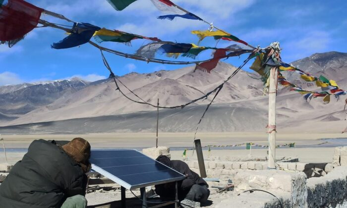 Solar electric panel being installed for the first time in the village Dungti on the de facto India-China border by Global Himalayan Expedition on Feb. 14, 2021. (Pic courtesy GHE)