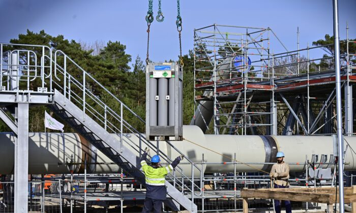 Men work at the construction site of the Nord Stream 2 gas pipeline in Lubmin, northeastern Germany, on March 26, 2019. (Tobias Schwarz/AFP via Getty Images)