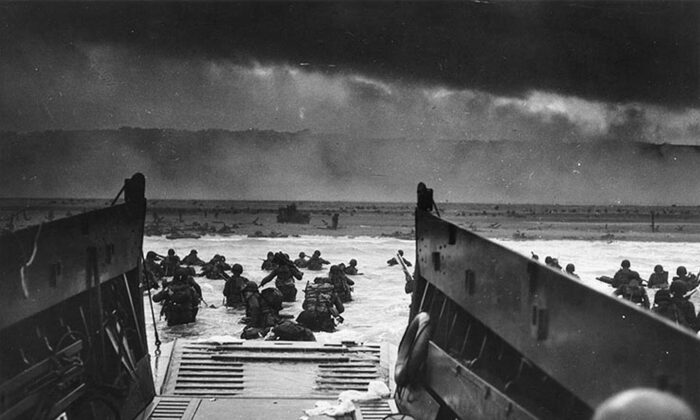This photo shows the U.S. Army troops wading ashore at Omaha Beach in north-western France, during the D-Day invasion, on June 6, 1944. (Robert F. Sargent/STF/National Archives/AFP/Getty Images)