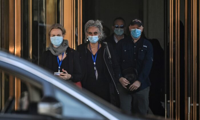 (L-R) Thea Fischer, Marion Koopmans, Peter Daszak and other members of the World Health Organization (WHO) team investigating the origins of the Covid-19 pandemic, leave the Hilton Wuhan Optics Valley Hotel in Wuhan, on Jan. 29, 2021. (HECTOR RETAMAL/AFP via Getty Images)