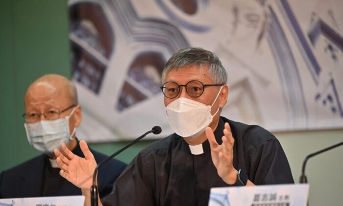 Newly appointed Bishop of Hong Kong Rev. Stephen Chow (R) speaks at a press conference with Cardinal John Tong (L) in Hong Kong on May 18, 2021. (Peter Parks/AFP via Getty Images)