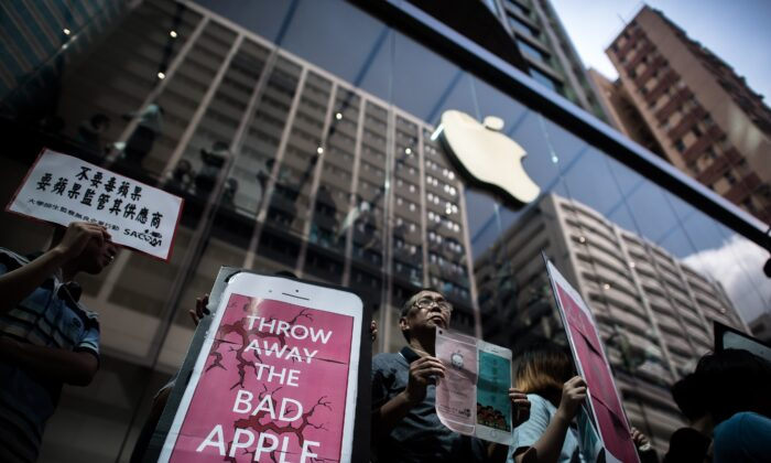 Rights campaigners stage a protest coinciding with the launch of the new iPhone 6s outside an Apple store in Hong Kong on Sept. 25, 2015.  Apple was urged to act as rights campaigners said a Chinese touchscreen glass supplier to the smartphone giant was exploiting factory workers. (Philippe Lopez/AFP via Getty Images)