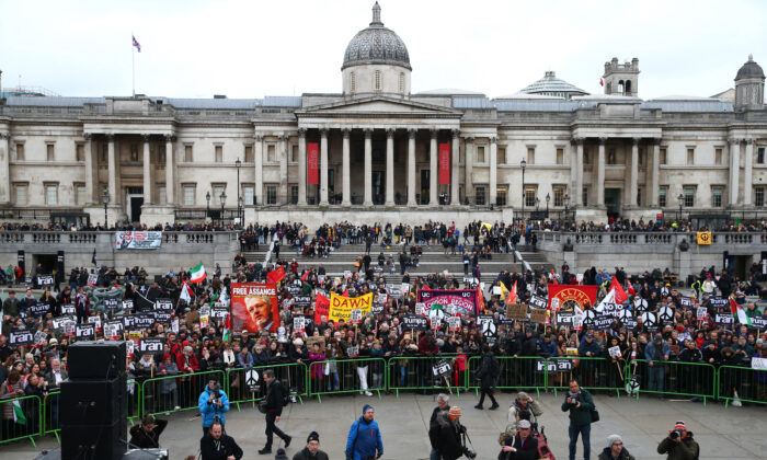 Three days after a Ukrainian airliner was shot down in Tehran, protesters attend a rally against the threat of war against Iran in Trafalgar Square, London, on Jan. 11, 2020.  (Hollie Adams/Getty Images)