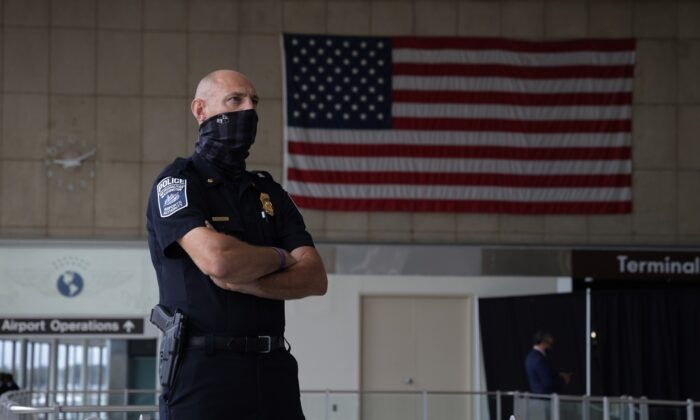 A Metropolitan Washington Airports Authority Police officer looks on during a news conference at Ronald Reagan Washington National Airport in Arlington, Va., on May 25, 2021. (Alex Wong/Getty Images)