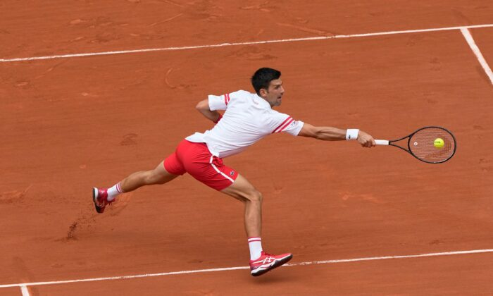 Serbia's Novak Djokovic plays a return to Italy's Lorenzo Musetti during their fourth round match on day 9, of the French Open tennis tournament at Roland Garros in Paris, France, on June 7, 2021. (Michel Euler/AP Photo)