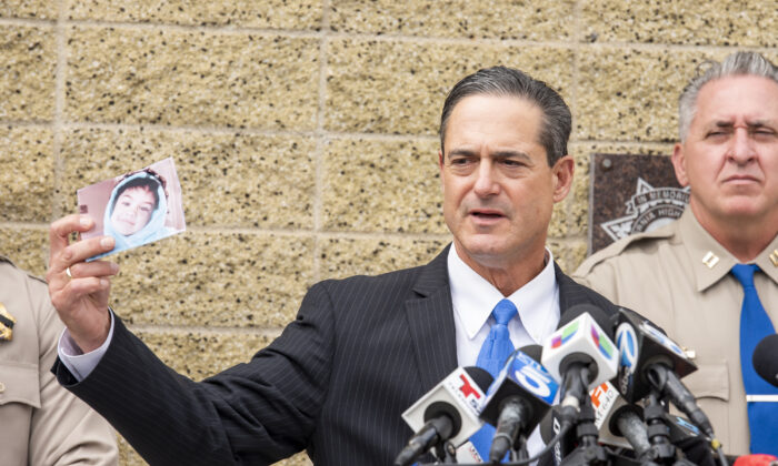 Orange County District Attorney Todd Spitzer holds up a photo of Aiden Leos during a news conference outside the CHP office in Santa Ana, Calif. on June 7, 2021. (Leonard Ortiz/The Orange County Register via AP)