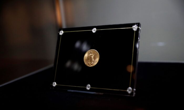 The 1933 Double Eagle coin is seen encased during a media preview before the auction at Sotheby's in New York City, on June 4, 2021. (Shannon Stapleton/Reuters)