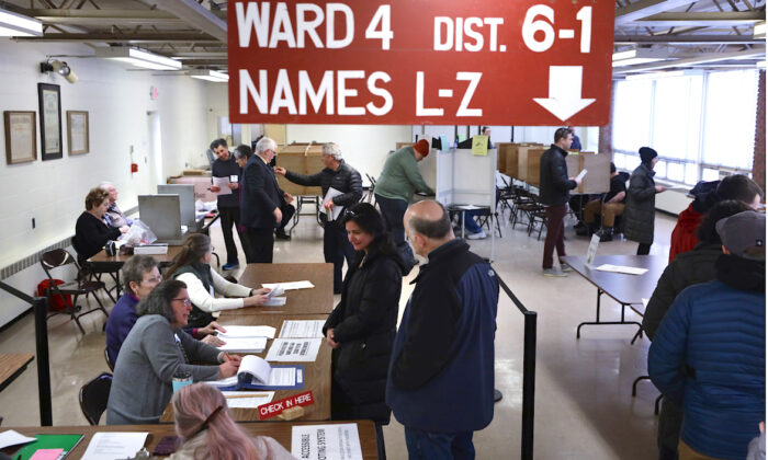 Voters wait for checking in at a polling place to cast their votes at Saint Mark's Youth Center in Burlington, Vt., on March 3, 2020. (Alex Wong/Getty Images)