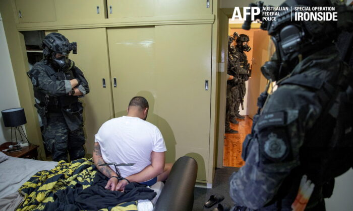 A suspect is detained by Australian police in a sting against organized crime in this undated handout photo released on June 8, 2021. (Australian Federal Police/Handout via Reuters)