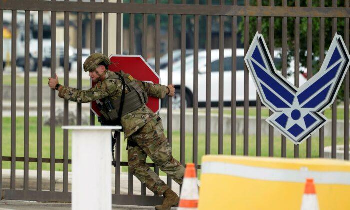 A military policeman closes a gate at JBSA-Lackland Air Force Base gate in San Antonio, Texas, on June 9, 2021. (Eric Gay/AP Photo)