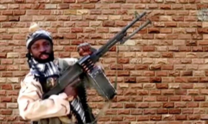 Boko Haram leader Abubakar Shekau holds a weapon in Nigeria in this still image taken from an undated video obtained on Jan. 15, 2018. (Boko Haram Handout/Sahara Reporters via Reuters)