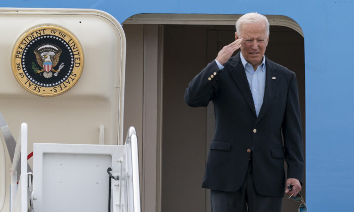 President Joe Biden salutes as he boards Air Force One at Andrews Air Force Base, Md., on June 9, 2021. (Alex Brandon/AP Photo)