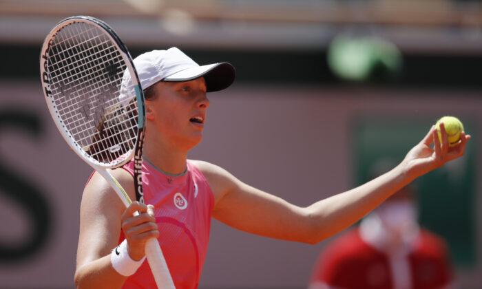 Poland's Iga Swiatek reacts during her quarter final match against Greece's Maria Sakkari at Roland Garros in Paris, France, on June 9, 2021. (Gonzalo Fuentes/Reuters)