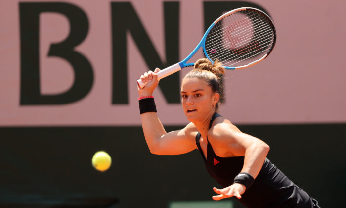 Maria Sakkari of Greece hits a forehand during her Ladies Singles Quarter-Final match against Iga Swiatek of Poland on Day Eleven of the 2021 French Open at Roland Garros in Paris, on June 9, 2021. (Clive Brunskill/Getty Images)